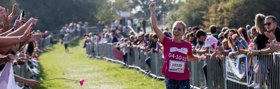 Half-marathon header image - Participant crossing the finish line