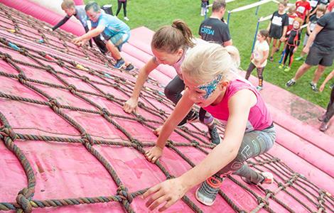 Girls climbing during Pretty Muddy Kids